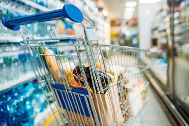 shopping cart with purchases in supermarket
