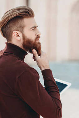 Bearded man with tablet