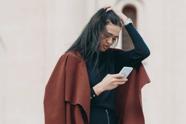 stylish woman using smartphone