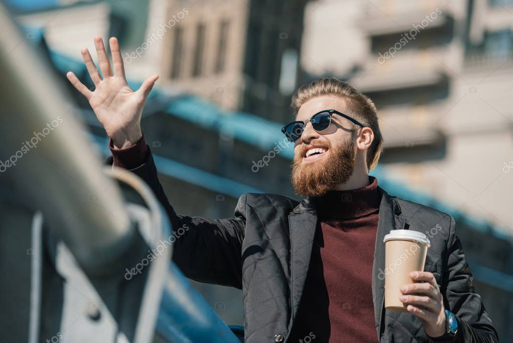 man with disposable cup of coffee