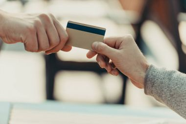 woman giving credit card to man
