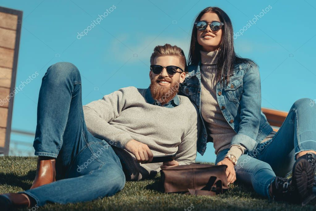 couple sitting on grass