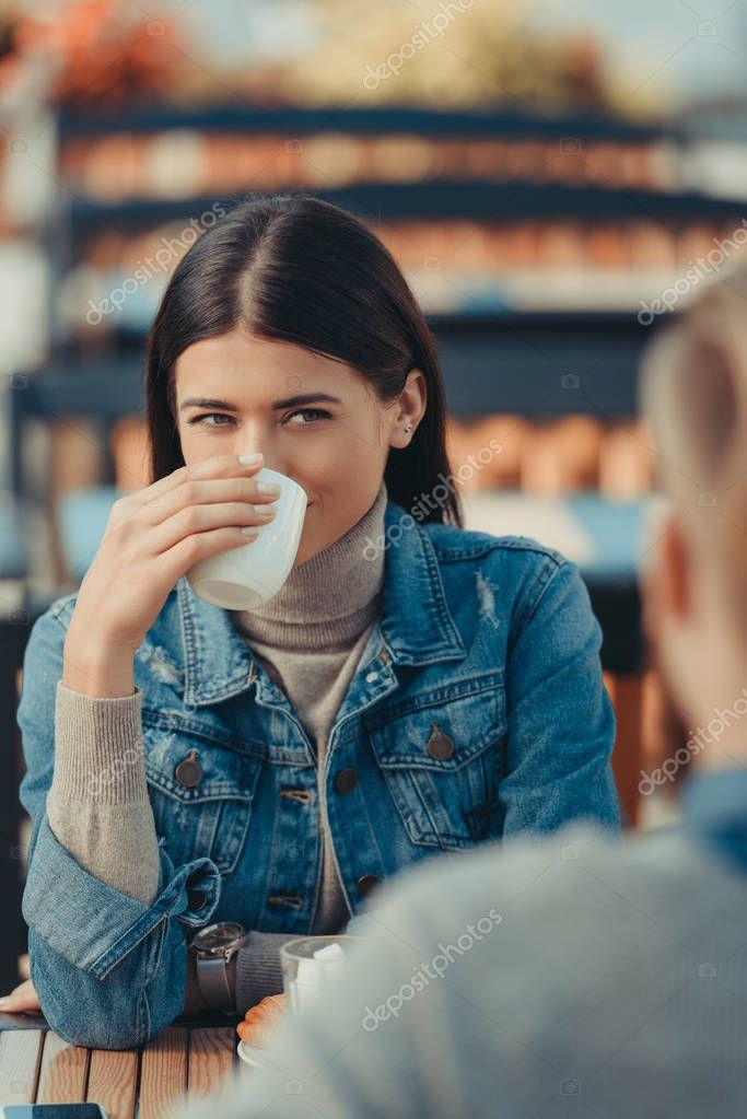 woman drinking coffee with boyfriend
