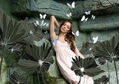 Fotografie young seductive woman with butterflies