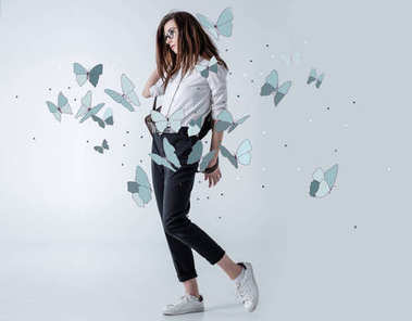 Stylish hipster woman with butterflies