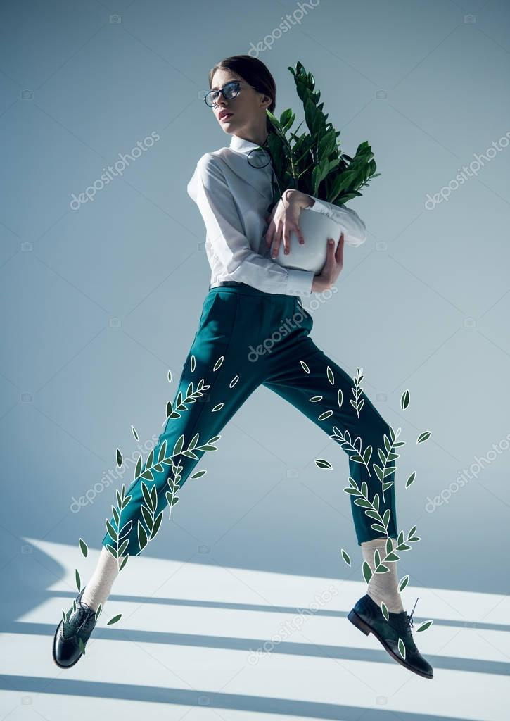 Young stylish hipster woman in white shirt and glasses jumping with green plant in flowerpot in hands stock vector