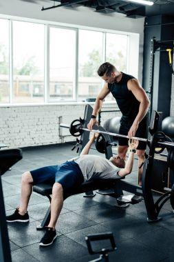 senior sportsman training with trainer