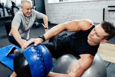 sportsman training with medicine ball