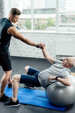 senior sportsman on fitness ball