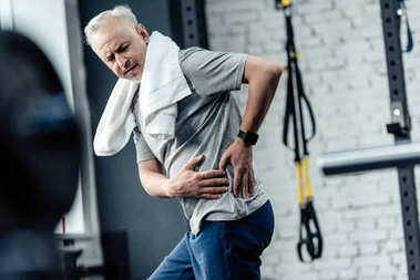 senior sportsman with back pain