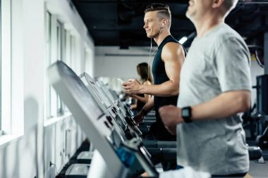 Sportsmen training on treadmills