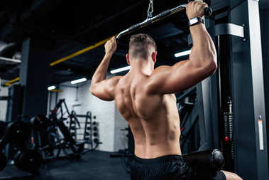 muscular sportsman lifting weights