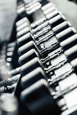Row of dumbbells in gym