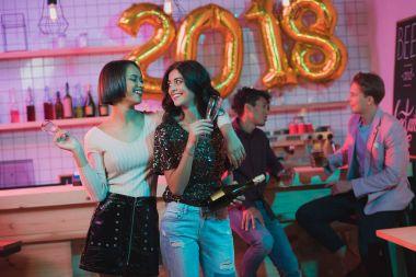 Multiethnic women celebrating new year