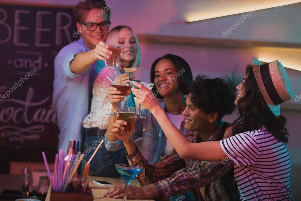 multiethnic friends having party