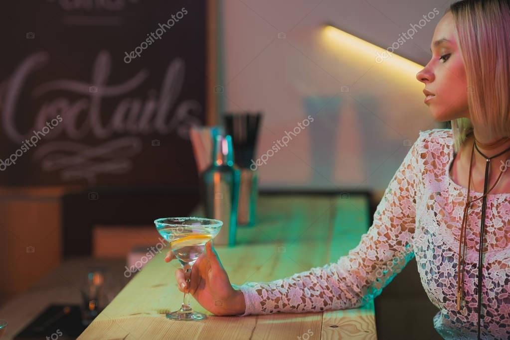woman with cocktail in bar