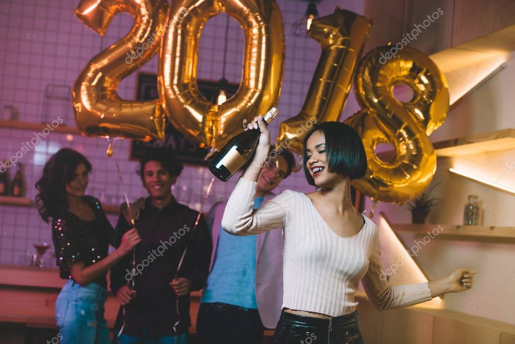 african american woman with bottle of champagne