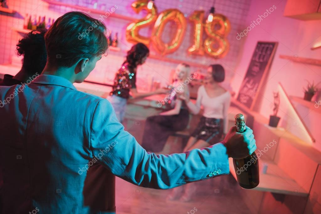 man brought bottle of champagne on party