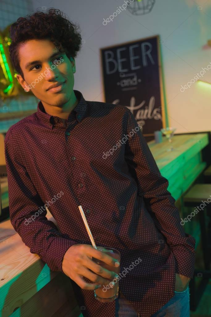 african american man with drink