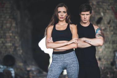 man and woman in sportswear