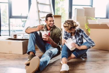 couple eating in new house