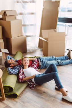 couple resting in new house
