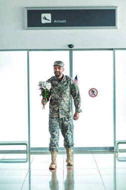 Soldier with bouquet of flowers