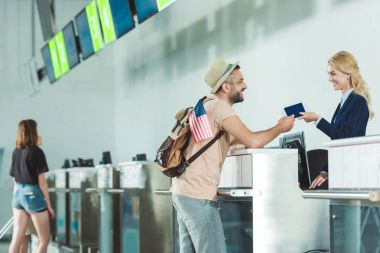 man at check in desk at airport