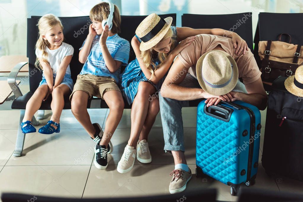 family waiting for boarding at airport