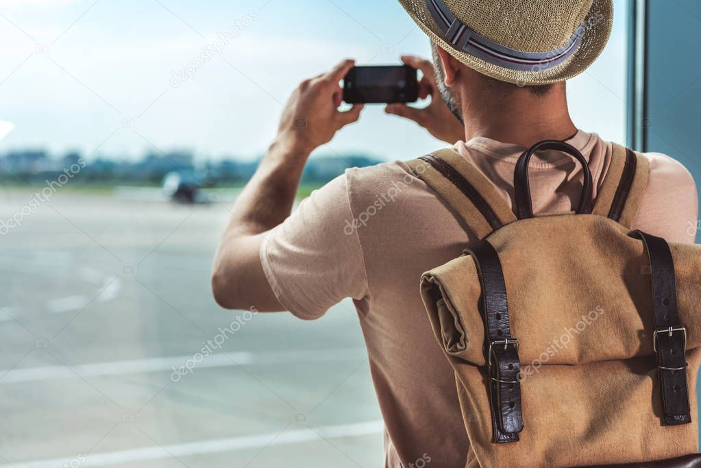 man taking picture on smartphone