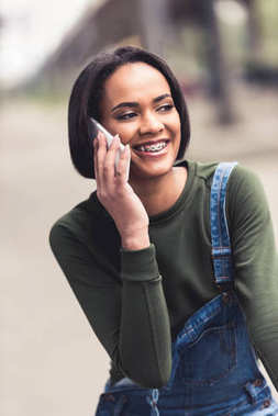 Young happy african american woman talking by phone stock vector