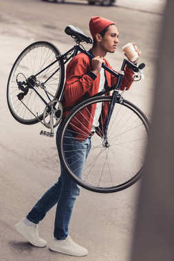 Thoughtful man carrying vintage bicycle and drinking coffee to go stock vector