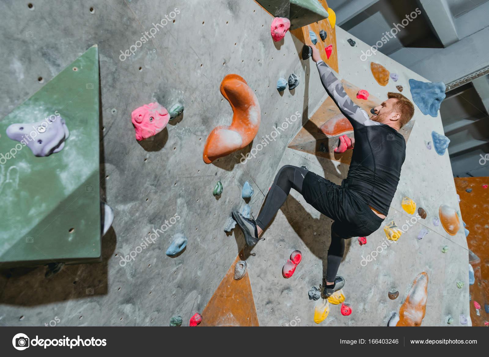mann-kletterwand mit griffen — stockfoto © arturverkhovetskiy #166403246