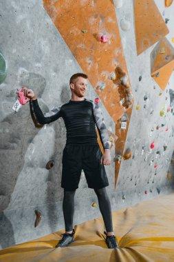 young man near climbing wall