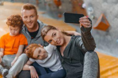 Family taking selfie at gym