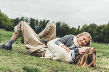 Family lying on grass at countryside