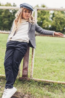 Stylish child at countryside