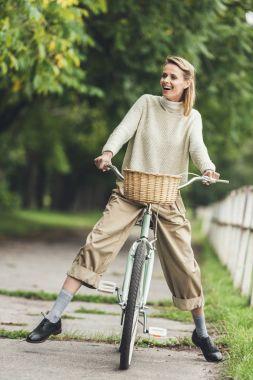 Stylish woman on bicycle