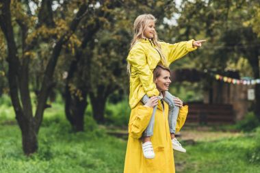 Mother and daughter in raincoats