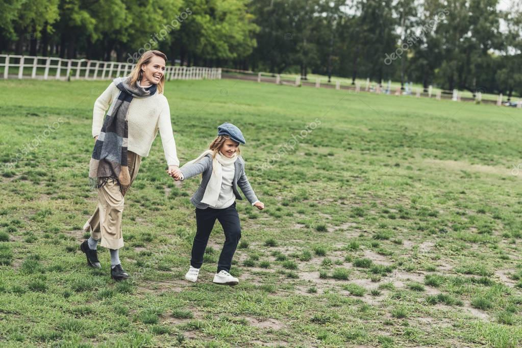 mother and daughter walking at countryside