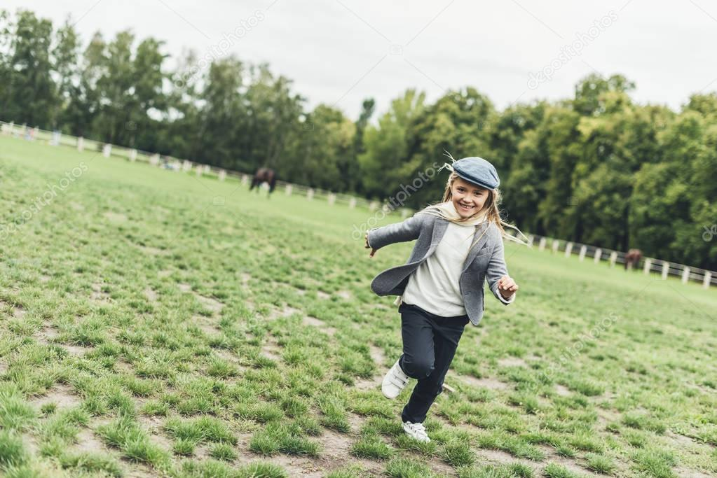 cheerful child at countryside