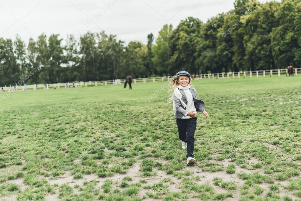 kid running at countryside