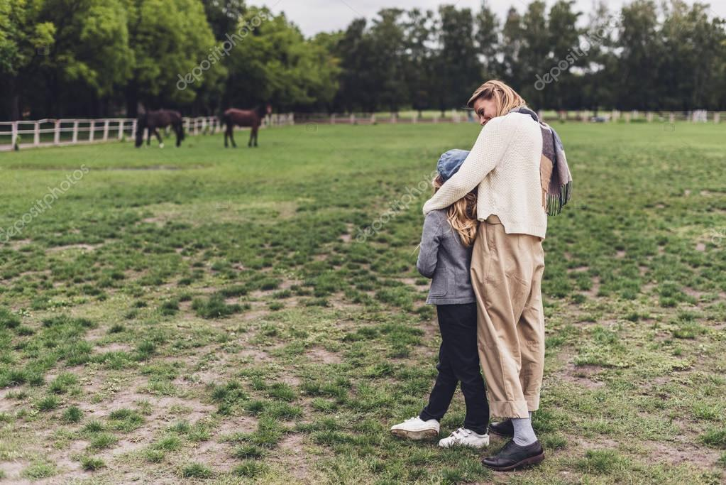 mother and daughter at countryside
