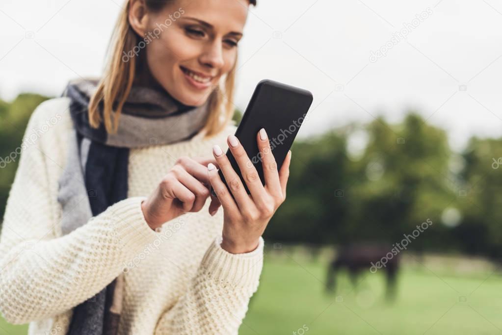 attractive woman using smartphone