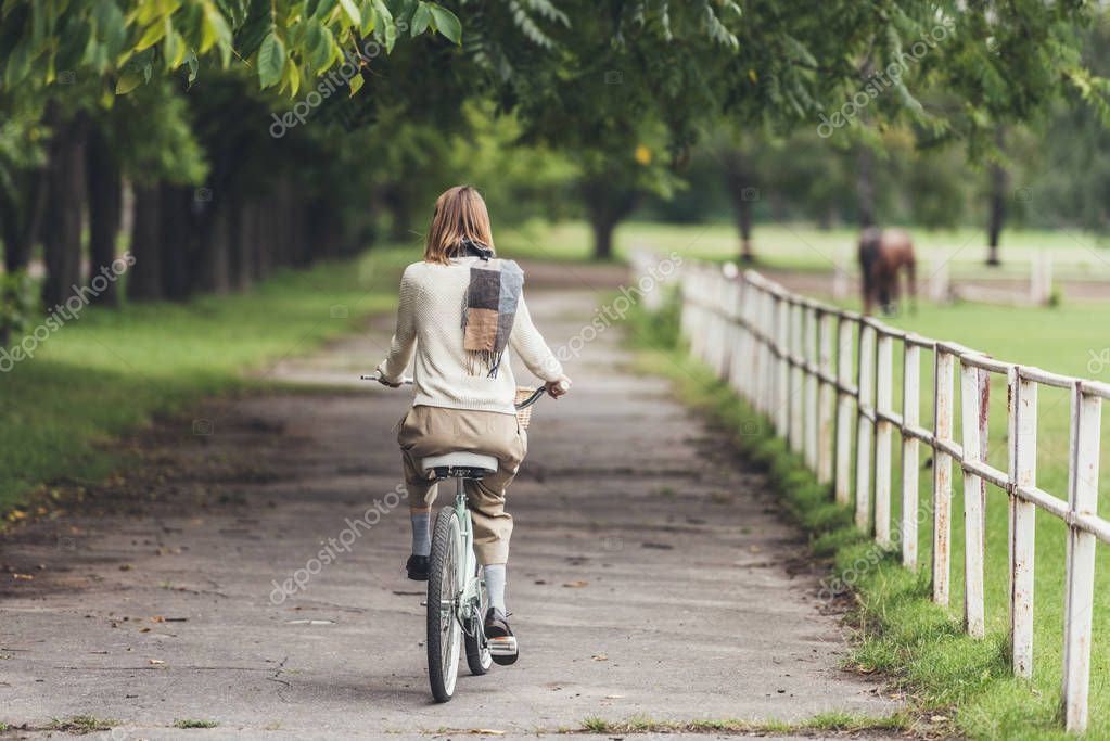 woman riding bike at countryside