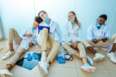 interns napping is hospital corridor