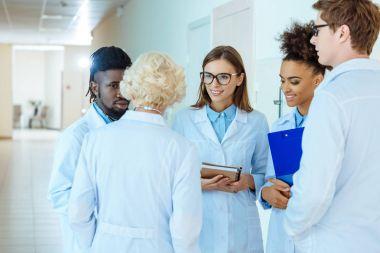 medical interns discussing work