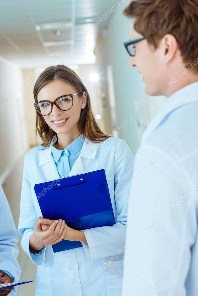 medical intern in lab coat and glasses