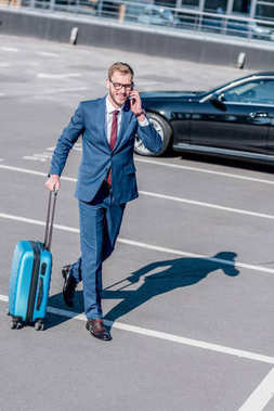 Businessman with suitcase for trip