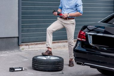 man changing car tire